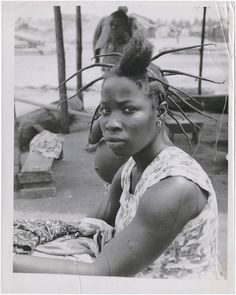 African threaded hair: how can you do this to a 5 yr old?  (C) Richard Wright 1953