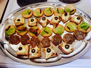 Canapés: Camembert and olives, smoked oyster, pate on a variety of savoury biscuits
